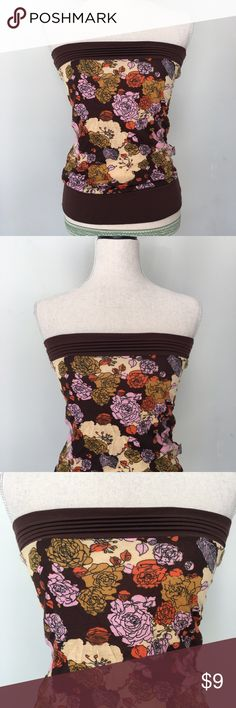 Floral Tube TopLike New Floral print tube top in like new condition. Hugs at the bust and at the bottom. It's a bit loose around the midsection area. No size on it but it fits like a small/medium. Bought in Thailand. Tops