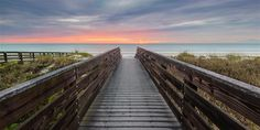 This long exposure panoramic photograph depicts a sunset at the end of a stormy April day on Indian Rocks Beach in Florida.