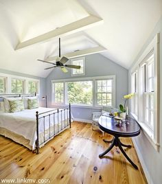 Spacious bedroom with wide pine floors and expansive windows from which to admire the field views... Parsonage Woods Road, West Tisbury, MA (Martha's Vineyard)