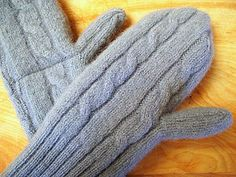 Mittens made by cutting and stitching the sleeves of an old, felted sweater.