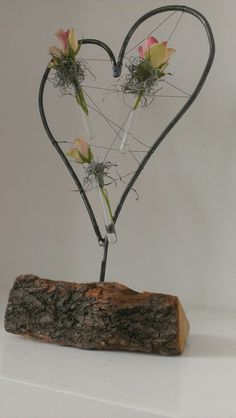 Stalen hart, buisjes, bloemen en een stukje hout voor de openhaard :)