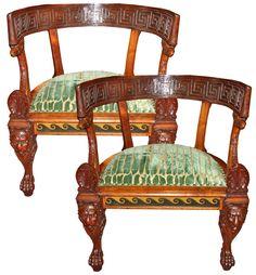 A Rare Pair of 19th Century Italian Neoclassical Rosewood Marquise Chairs, the back rail carved with a Greek key pattern, the tight upholstered seats flanked with anthemion motifs above the seat rail painted with vitruvian scrolls, the whole raised on legs terminating in lions paw feet and with the knees of the two front legs accented with winged lions, symbolizing St. Mark the Evangelist