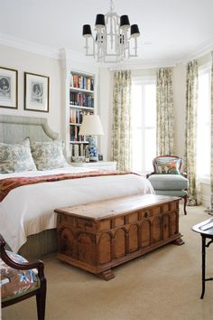 For the more traditional types, this bedroom would be your cup of tea. Chinoiserie on the bedding and tall window coverings give the space some colour, while the repainted chandelier acts as a strong focal point.
