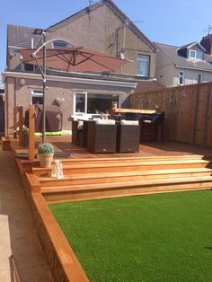 My garden astro turf grass & cedar wood decking Hot tub & bar