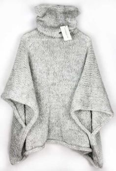 Cuddly knitted poncho for winter with a high collar / knitted cape for . Cuddly knitted poncho for winter with a high collar / knitted cape for the winter season, knitwear made by Alexandra Mil. Poncho Pullover, Poncho Sweater, Cardigan Pattern, Baby Cardigan, Diy Tricot Crochet, Knitted Cape, Cozy Knit, Warm Sweaters, Knitting Sweaters