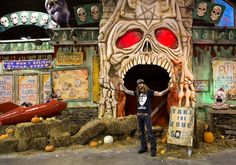 "Rob Zombie poses in front of House of 1,000 Corpses, one of the three ""sick, twisted"" haunted houses based on his movies that are part of Gr..."