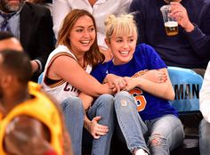 Miley Cyrus And Her Engagement Ring Had The Most Fun At The Knicks Game - http://www.jfashion.co.uk/jfashion/blog/miley-cyrus-and-her-engagement-ring-had-the-most-fun-at-the-knicks-game/        James Devaney/Getty Images     Miley Cyrus was all laughs, smiles and tongue wags on the New York Knicks recreation at Madison Square Garden on Saturday. Ditching her favourite Bulls jersey for the Knicks' blue and orange, Cyrus rocked some new blond bangs and, in fact, her engagement