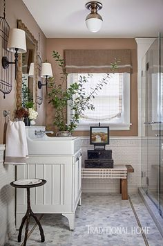 The barn-style vanity cabinet, birdcage murals, and timber mirror all allude to the beauty of nature just outside. - Photo: Dustin Peck / Design: Miyuki Yamaguchi