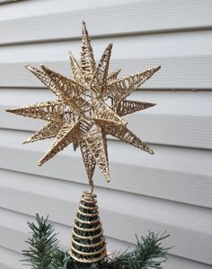 A textured, gold shimmering 3D star for your medium to large Christmas tree for that added holiday charm. Overall it measures 11 1/2 high x 8