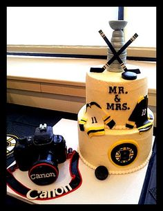 Cannon camera & Bruins cake made for a Jack & Jill wedding shower