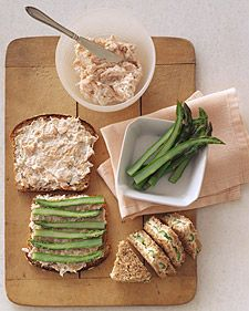 In our little tea sandwiches, cooked asparagus is layered with a mixture of poached salmon, horseradish, and nonfat sour cream over whole-grain bread.  The spread can be made an hour or two ahead and chilled; assemble sandwiches just before serving.