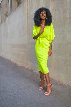 stylepantry wearing a gorgeous neon midi wrap dress