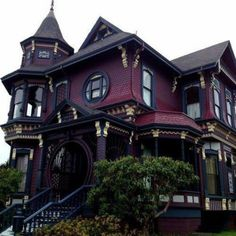 Pin for Later: Gothic Homes So Gorgeous, We Wouldn't Mind If They Were Haunted!  The rounded windows and oxblood walls of this breathtaking home make it stand out from the crowd.