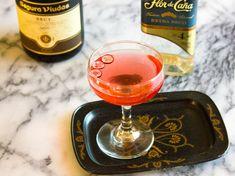 Spiced Cranberry Rum Fizz - Spiced Cranberry Mixer, Dry Sparkling Wine, Cranberries.