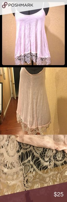 Baby pink lace trim tank Make an offer!! Will negotiate!! Super adorable baby pink lace trim tank with a scoop neck and almost like a hi-lo tank. Marked size S but because of the flow fit it could fit from a L-XS works in summer heat and with a cardigan in the fall. Worn less than the fingers on one hand. Tops Tank Tops
