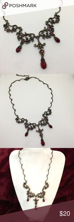 """Vintage Avon """"Vintage Scroll"""" Necklace A gorgeous antique gold-plated Avon necklace with deep red Aurora crystals and rhinestones, set in a Victorian-style setting. Adjustable up to 19"""". Marked as shown, along with the manufacturer's mark """"SP"""" on the reverse. In excellent vintage condition. These necklaces are a little rare, especially in this condition! This piece appears perfectly preserved with little if any signs of wear! Vintage Jewelry Necklaces"""
