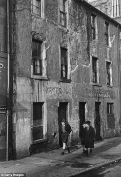 A group of boys walking along a street in the run-down Gorbals (Glasgow) area. The tenements there were built quickly and cheaply in the 1840s.