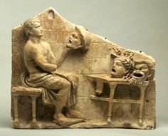 Roman, Republican or Early Imperial Relief of a seated poet (Menander) with masks of New Comedy, 1st century B.C. – early 1st century A.D. White marble, probably Italian