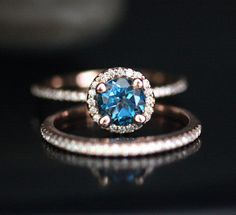 14k Rose Gold 6mm London Blue Topaz Round and Diamonds Engagement Ring and Wedding Band Set (Choose color and size options at checkout) by Twoperidotbirds on Etsy https://www.etsy.com/listing/203203068/14k-rose-gold-6mm-london-blue-topaz