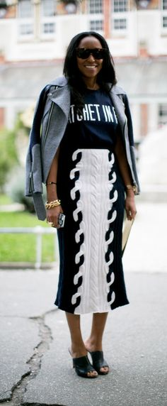 Draping your jacket over your shoulders is a fashion editor styling trick.