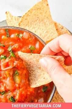 A super easy chunky salsa recipe that is low in sugar and full of healthy ingredients, wow your guests with your homemade salsa abilities or simply enjoy the bucket loads of cooked salsa you can make for the same price as a small jar. Easy to find ingredients with fresh tomatoes and canned crushed tomatoes both involved. Adjust the chili pepper and hot sauce to make it as spicy as you want. Make it and add your photo to the pin, you won't be sorry! Easy Chunky Salsa Recipe, Homemade Chunky Salsa, Homemade Salsa, Spicy Vegetarian Recipes, Vegetarian Side Dishes, Vegan Main Dishes, Vegan Recipes, Eating Vegetables, Vegan Appetizers