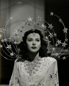 Ziegfeld Girls, 1941 Costume design: Adrian  white gown with embroidered sequin stars and silver star headpiece - worn by Hedy Lamarr in the role of Sandra Kolter