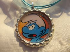 Smurfs cap necklace with cord - made from a real comic book. $6.99, via Etsy.