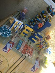 Golden State Warriors basketball party mini dessert table setup. Yellow and blue