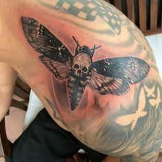 Black and white realistic skull moth Tattoo by Elvin Yong
