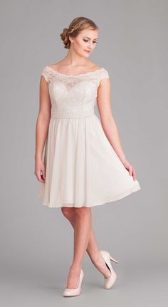 A beautiful illusion neckline dress with cap sleeves. Great option for a rehearsal dinner or informal wedding dress.