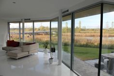 Stunning #lakeviews are afforded by sliding glass doors to this unique home. The Flint House saw slim framed #slidingglassdoors installed to both sides of the ground floor to enhance the #naturallight intake into the living areas.   The sliding doors also provide seamless access to the patio area throughout the year, creating an indoor-outdoor living space. With a #slimsightline of only 21mm, these sliding doors help to maximise the light intake as well as increasing the views of the lake Sliding Glass Door, Sliding Doors, Glass Doors, Living Area, Living Spaces, Indoor Outdoor Living, Outdoor Decor, Ground Floor, Ramen