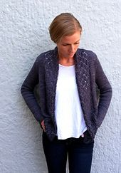 Pretty lace panels and a back pleat make for a classic and feminine cardigan.