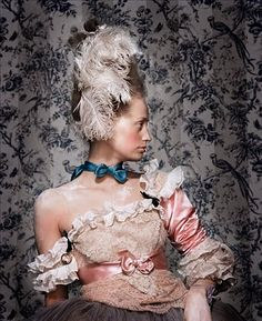 18th Century France, the era of Marie Antoinette for example, was glimmering and exploding with romantic Rococo style glamour and lavish ornamentation.