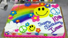 Happy hippie cake. Smiley faces, peace signs and 60's flowers.  Airbrushes rainbow.