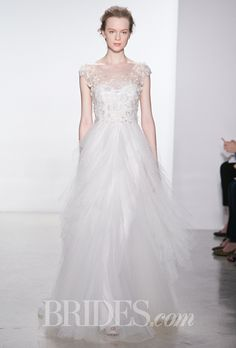 Floral lace A-line wedding dress with an illusion scoop neckline, cap sleeves, and a point d'esprit ruffle skirt, Christos
