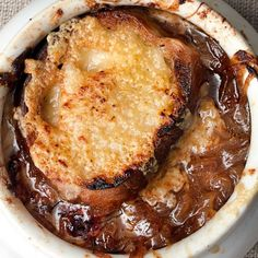 Our Favorite French Onion Soup 5 tablespoons unsalted butter,  1 tablespoon vegetable oil 3 pounds Vidalia onions (about 4 medium), halved lengthwise, peeled, and thinly sliced 1 teaspoon kosher salt 1/2 teaspoon ground black pepper 1/2 teaspoon granulated sugar 1 1/2 cups dry white wine 6 cups homemade beef broth or store-bought low-sodium beef broth 10 sprigs thyme 2 bay leaves 1 baguette 1 garlic clove, cut in half lengthwise 2 teaspoons sherry, preferably Fino or Manzanilla 4 ounces…