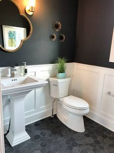 Modern Home Trends I'm Loving - Black and White Modern Bathroom with Wainscotting and Hex Tile - Bathroom Wallpaper Uk, Wainscoting Bathroom, Downstairs Bathroom, Bathroom Renos, White Bathroom, Bathroom Flooring, Bathroom Renovations, Bathroom Interior, Modern Bathroom