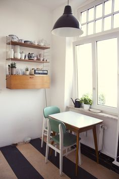 Love the stripe design of the linoleum.  Great idea!  Small kitchen table
