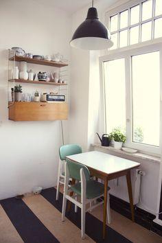 Love the stripe design of the linoleum.  Great idea!  Small kitchen table