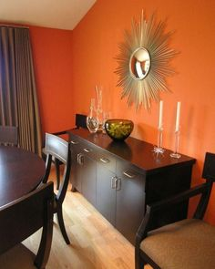 Warm up a formal living & dining room with a punchy paint color