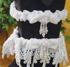 Set of 2  Garters - Toss and Keepsake Garter, The Keepsake wedding garter is made with Venetian style lace, has a satin bow accent with faux pearls. The matching tossing satin wedding garter is adorned with the same white satin bow and faux pearl trim.