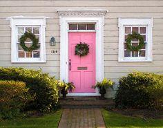 ridiculous curb appeal - pink door, wood detail, topiaries, brick path.  wow