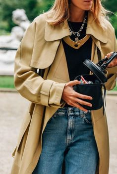 The mini bag + the outsize coat. Everything we want to wear now. Street Style Tommy Ton.