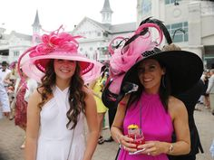 Women in derby hats pose for a photo before the 2016 race