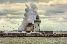 Storm Waves At The Cleveland Lighthouse Photograph by Richard Kopchock