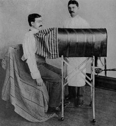 """Dr. Hans Pibb (right) and unidentified patient, 1906.  Known for his many innovations in the field of medicine, Dr. Hans Pibb (1870 - 1928) perfected the only working one-of-these-things (see photo, above). """"I worked all my life to make one of these things,"""" Pibb said at the contraption's unveiling in 1906. """"For those people who had that problem with the what-do-you-callit, this one-of-these-things, this one, right here, the thing I'm pointing at right now, this will help them."""" Pibb went on…"""