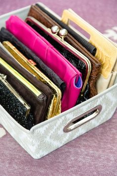 STAPLES STORAGE TIP: Put small accessories, like purses, scarves and gloves, in their places. Decorative shelf totes keep small items that would otherwise get smushed in an orderly lineup.