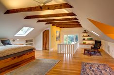 LED lighting is used throughout the space. It's concealed in grooves on the beams to uplight the ceiling.