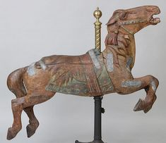 Early 20th century carved carousel horse Lot 308