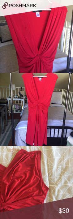 """Red Dress Sleeveless V red dress. Stretchy, travels easily without wrinkling. Gathered a bit front center. Sash ties in back to create flattering shape. Calf length on 5'6"""". Dresses Midi"""